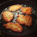 Potato pancakes in a frying pan.jpg