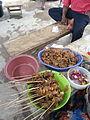 Preparation of snail khebabs.jpg