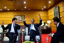 Justin Trudeau with President Barack Obama throwing hamds in air as Enrique Peña Nieto looks on