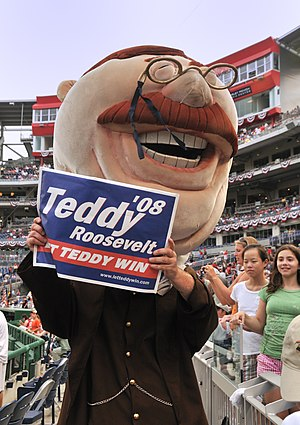 Presidents Race - Teddy Roosevelt displays a campaign rally sign at Nationals Park.