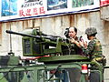 ROCMC Soldier Tutoring Visitor Operate T-75M 20mm Cannon 20140327.jpg