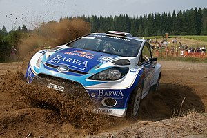 English: Nasser Al-Attiyah driving his Ford Fi...