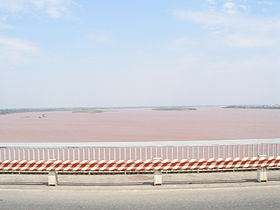 Red River view from bridge in Hanoi.jpg