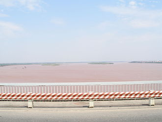 Red River (Asia) - The reddish-brown heavily silt-laden water gives the river its name. View from bridge in Hanoi, Vietnam