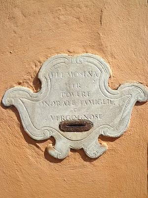 San Gregorio della Divina Pietà - Alms slot on the north wall