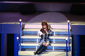 Risa Niigaki - Niigaki performing at Morning Musume's Platinum 9 Disco concert tour in May 2009