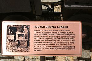 Rocker Shovel Loader - An engraved copper plaque next to the Rocker Shovel at Bingham Canyon Mine.