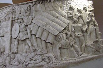 Scutum (shield) - The testudo performed during a siege, as shown on Trajan's Column. There are faint eagle-wing and thunderbolt motifs on the scuta.