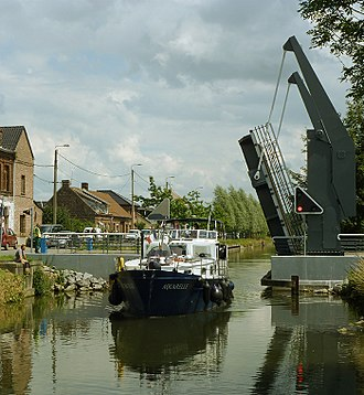 Canal de Roubaix - The 17m-long motor yacht Aquarelle passes through the Grimonpont lift bridge on the recently reopened canal