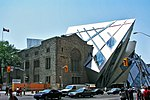 Exterior facade of the Royal Ontario Museum from across the intersection of Bloor Street and Avenue Road
