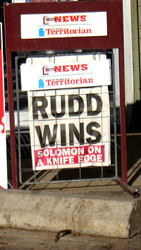 The front page of The Sunday Territorian at a corner store in the Northern Territory the day after the election indicating the outcome, with the marginal local seat of Solomon not being claimed until December 7.