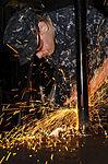 Sailor performs grinding 130207-N-KE148-102.jpg