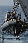 Sailors conduct operations in a rigid hull inflatable boat DVIDS233595.jpg