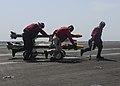 Sailors move ordnance across the landing area aboard USS Nimitz. (36169646860).jpg