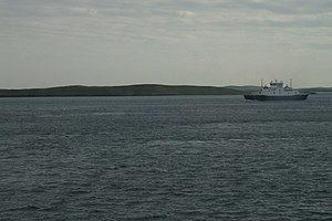 Samphrey - Samphrey with one of the Yell Sound ferries passing