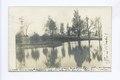 Scene on a S.I. Farm (pond, trees and windmill) (NYPL b15279351-104729).tiff