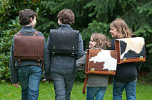 Children carrying leather and cowhide satchels.
