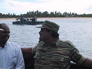 Soosai - Colonel Soosai with Pulidevan on fibreglass fast attack craft at Mullaitivu, Sri Lanka, 2003