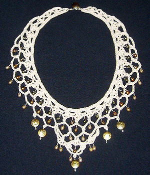 Necklace made from crochet lace, pearls, and sterling silver