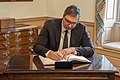 Serbian President Vucic Signs the Guest Book (49608639573).jpg