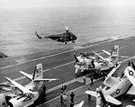 Sikorsky CH-19E of HU-1 in flight over USS Constellation (CVA-64), 11 May 1963 (NNAM.2011.113.403).jpg