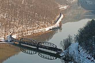 CSX Transportation - A long CSX coal train of empty hoppers crosses the New River as seen from Hawks Nest State Park