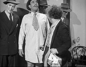 "Brauer poses as a mannequin in Sing a Song of Six Pants . However, Stooge Larry Fine notices there is something a little too human about the ""dummy."" Sing a Song of Six Pants.JPG"