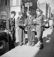 Squadron Leader J Macadam meets three Norwegian resistance fighters in Oslo following the arrival of British forces in Norway, 11 May 1945. CL2635.jpg