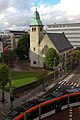 St. Jakob church Bergen with Bergen Light Rail.jpg