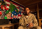 Staff Sgt. William Beal poses for a photo after finishing an Avengers-themed mural (8138569200).jpg