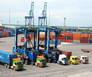 Straddle carriers and trucks in a port