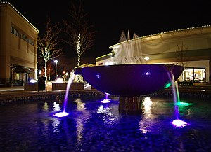 The Streets of Tanasbourne - Fountain at the center at night