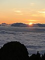 Sunset looking down on the clouds (399985041).jpg
