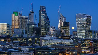 Economy of the United Kingdom - Image: Super moon over City of London from Tate Modern 2018 01 31 4