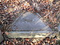 Survey monument RH00-062 E witness stone.jpg