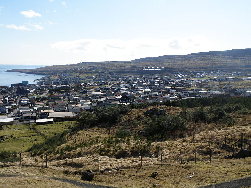 View over Tórshavn and Argir. Tórshavn is the capital of the Faroe Islands. Argir and Tórshavn have grown together. Argir is south of Tórshavn, there are some high buildings to the left on this photo, these are the National Hospital of the Faroe Islands or building which belong to the hospital. Argir is further south than the hospital. This photo is taken near Oyggjarvegur and Hotel Føroyar, which are above the town of Tórshavn. The centre of Tórshavn and the eastern part of the town along with other parts are not visible on this photo. Most of the western part of Tórshavn is visible on this photo and a large part of Argir.