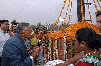 T. V. Rajeswar - T. V. Rajeshwar paying floral tributes at the Kranti Memorial at Meerat, on the occasion of the commemoration of the 150th years of Indian Rebellion of 1857 in Meerut (UP) on 6 May 2007.