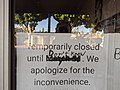 Temporarily closed until don't know sign, boarded shop window, Magnolia Park, Burbank, California, USA.jpg