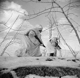 10th Indian Infantry Division - A patrol from No. 8 Platoon, 'C' Company of the 2nd Battalion, 3rd Gurkha Rifles advances cautiously through the snow, near Castel Bolognese, Italy, 23–24 January 1945.