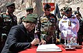 The President, Shri Ram Nath Kovind signing the visitors' book, during his visit to Siachen Base Camp on May 10, 2018. The Chief of Army Staff, General Bipin Rawat is also seen.JPG