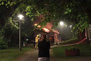 2013 Stockholm riots - The picture shows the burning Husby Gård, set aflame during the riots.
