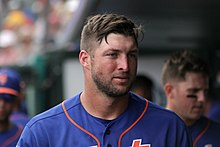 Tim Tebow in the dugout.jpg