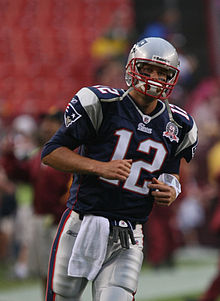 Tom Brady in football uniform, wearing uniform number 12