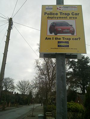 Bait car - A sign warning of a police trap car deployment area, in the United Kingdom