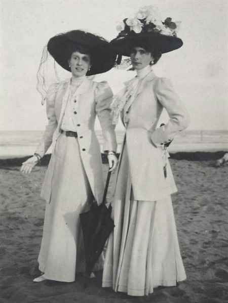 File:Two Women on Beach wearing large black hats 1900s.jpg
