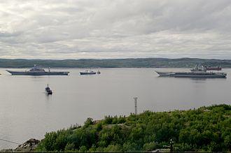 INS Vikramaditya - Vikramaditya (left) alongside the Russian aircraft carrier ''Admiral Kuznetsov'' in the port of Severomorsk in 2012