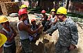 U.S. Army Sgt. Phil E. Chavez, right, an engineering and remodeling support specialist with the 176th Engineer Company, 96th Troop Command, Washington Army National Guard, jokes with Mongolian Armed Forces 130726-M-MG222-005.jpg