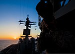 U.S. Marine Corps Cpl. Kyle Runnels, a 26th Marine Expeditionary Unit (MEU) combat correspondant, takes photos at sunset aboard the USS Kearsarge (LHD 3), at sea, July 13, 2013 130713-M-SO289-020.jpg