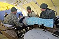 U.S. National Guardsmen assigned to the Chemical, Biological, Radiological, Nuclear and high-yield Explosives Enhanced Response Force Package, Oregon National Guard handle a simulated victim near Joint Base 140327-Z-CH590-461.jpg