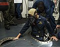 U.S. Navy Cmdr. Kevin Kennedy, the commanding officer of the guided missile destroyer USS Gravely (DDG 107), climbs into the chain locker during a zone inspection in the U.S. 6th Fleet area of responsibility 130807-N-KA046-020.jpg